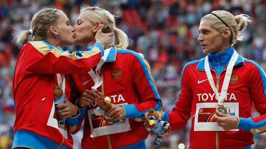 Aug. 17, 2013: Gold medallists team Russia kiss and celebrate at the women's 4x400 metres relay victory ceremony during the IAAF World Athletics Championships at the Luzhniki stadium in Moscow. From left: Yulia Gushchina, Kseniya Ryzhova, Tatyana Firova and Antonina Krivoshapka.
