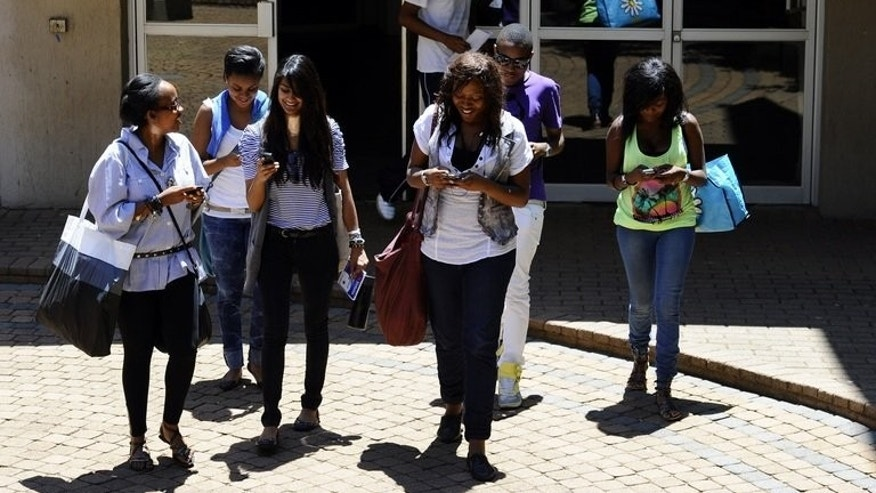 Students use their mobile phones after class on October 20, 2010 at the Witwatersrand University in Johannesburg. The university launched a campaign to attract Africa's top postgraduate talent Tuesday, intensifying the continent's battle for brains.
