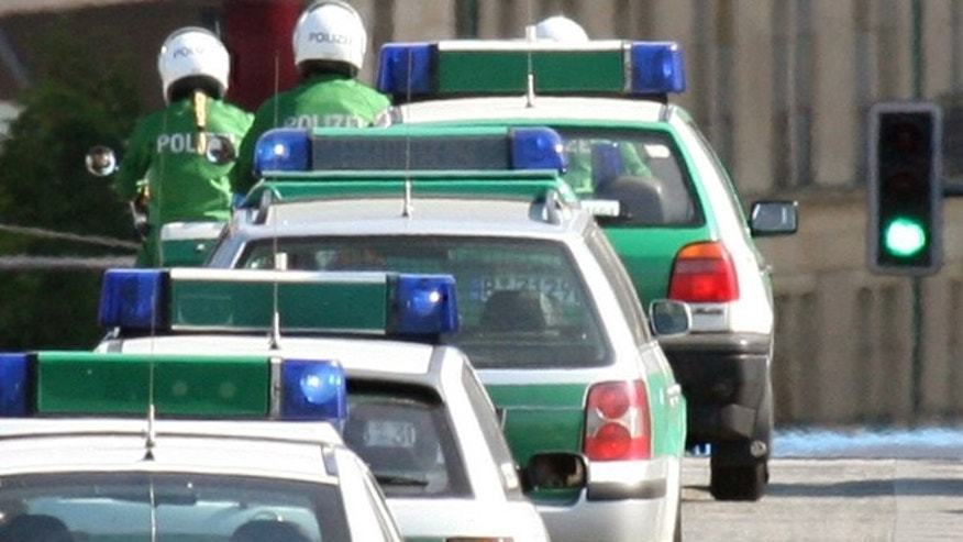 A convoy of police cars in Berlin on June 2, 2006. At least three people were killed and five others wounded Tuesday when a man opened fire in a restaurant in a small village in southern Germany, police said.
