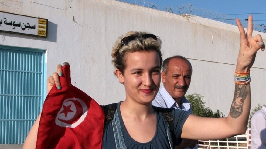 Tunisian activist Amina Sboui is released from jail on August 1, 2013 pending her trial for desecrating a cemetery. The campaigner who was detained for nearly three months, says she has left the radical women's protest group Femen, accusing it of Islamophobia.