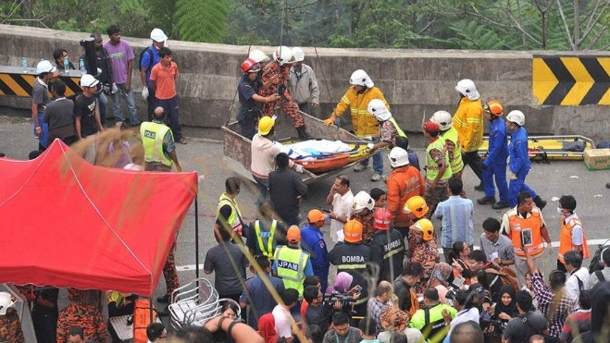 Aug. 21, 2013: Malaysian emergency services personnel rescue a passenger by a crane after a passenger bus carrying tourists and local residents fell into a ravine near the Genting Highlands, about an hour's drive from Kuala Lumpur, Malaysia.
