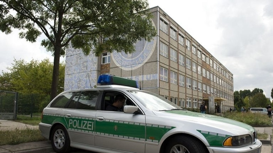 A police car parks next to a former high school now housing asylum seekers in the district of Hellersdorf-Marzahn in Berlin, Germany on August 21, 2013. German neo-Nazis have protested against a new political refugee centre in Berlin, seeking to stoke anti-foreigner sentiment a month before elections and sparking large counter-demonstrations.