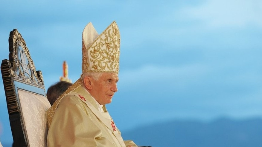 "This handout photograph provided by Osservatore Romano shows Pope Benedict XVI during a mass in Santiago de Cuba on March 26, 2012. Benedict XVI has said God told him to resign as pope and that his successor's ""charisma"" reflected this divine inspiration, Catholic news agency Zenit has reported."