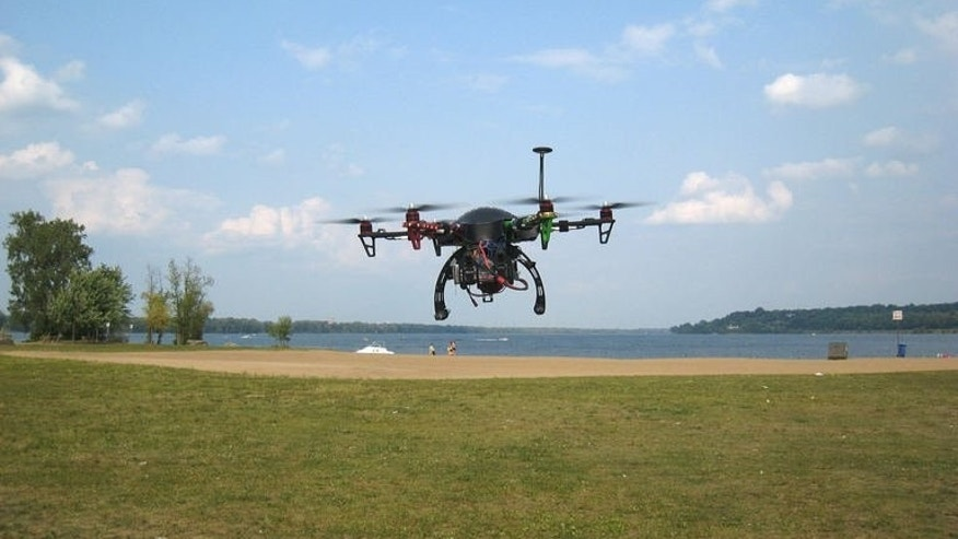 A drone hovers over Petrie Island park in Ottawa, Canada during a demonstration flight on August 21, 2013. Canada's capital has ordered drone strikes to rid a popular Ottawa beach of pesky geese that dirty the waters with fecal matter.
