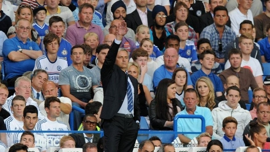 Chelsea's Portuguese manager Jose Mourinho gestures during the English Premier League football match between Chelsea and Aston Villa at Stamford Bridge in London on August 21, 2013. Chelsea won 2-1.