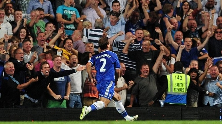 Chelsea's Serbian defender Branislav Ivanovic celebrates in front of supporters after scoring their second goal during the English Premier League football match between Chelsea and Aston Villa at Stamford Bridge in London on August 21, 2013. Chelsea won 2-1.