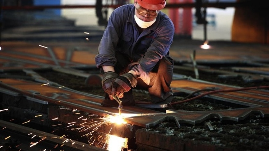 A worker welds steel in a factory in Huaibei, in north China's Anhui province on July 24, 2013. A closely watched indicator of Chinese manufacturing turned positive for the first time in four months in August, HSBC said Thursday, in a sign of renewed strength in the world's second-largest economy.