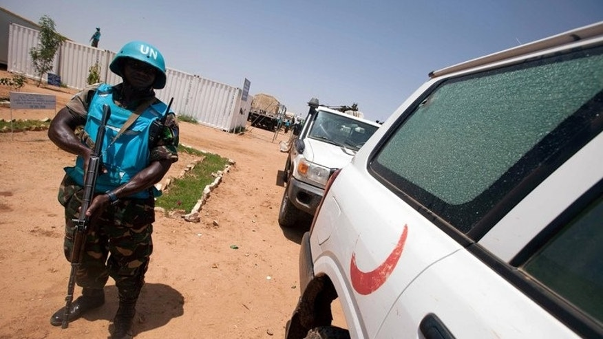 A UNAMID picture released on July 14 shows a military peacekeeper in Khor Abeche in South Darfur. Twenty-four people have been freed, four days after being abducted by a rival tribe in Sudan's Darfur region following deadly clashes between the two groups, official media said Wednesday.