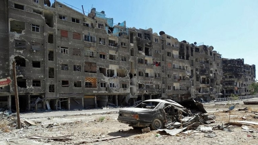 Image released by the Syrian opposition's Shaam News Network on August 17, 2013 shows heavily damaged buildings in Zamalka, a suburb of the Syrian capital Damascus. Dozens of people were killed or wounded in fierce army bombardment of areas near the Syrian capital on Wednesday, a monitoring group said, while activists charged that toxic gas was deployed.