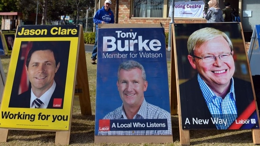 "People take part in pre-pool voting in western Sydney on August 22, 2013. Australian Prime Minister Kevin Rudd warned he was a fighter who should not be written off after a debate on August 21 in which election rival Tony Abbott asked: ""Will this guy ever shut up?"""