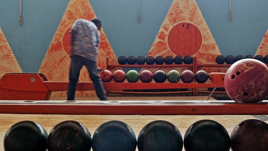 A visitor picks up a ball at a bowling alley in Asmara, the capital of Eritrea, on July 20, 2013. Asmara boasts buildings unlike anywhere else in Africa, a legacy of its Italian colonial past, when architects were given free reign for structures judged too avant garde back home.