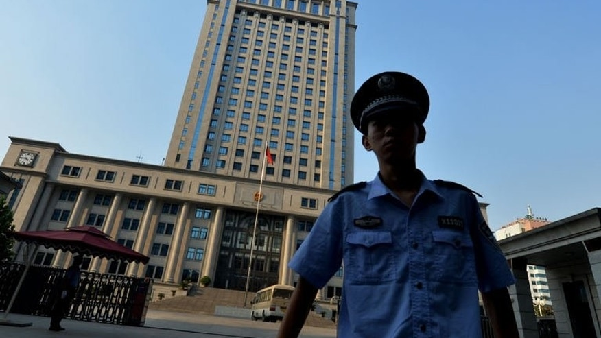 A policeman is pictured outside the Intermediate People's Court where disgraced politician Bo Xilai will soon go on trial in Jinan, Shandong Province on August 21, 2013.