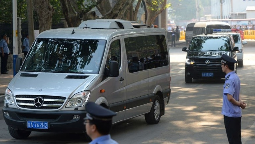 The convoy believed to be carrying disgraced politician Bo Xilai arrives at the Intermediate People's Court in Jinan, Shandong Province on August 22, 2013. Once one of China's highest-flying politicians, Bo found himself in the criminal dock on trial for bribery and abuse of power in the country's highest-profile prosecution in decades.