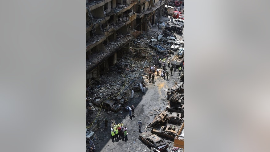 "A view of the destruction following a car bomb attack the previous day that killed at least 27 people in a Beirut stronghold of Shiite militant group Hezbollah, which backs Syria's embattled president, August 16, 2013. Hezbollah was already accused of running a ""state-within-a-state,"" but two car bombings in the area in as many months have spurred them to turn the suburbs into a fortress."