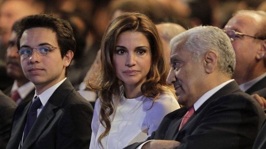 Jordanian Prime Minister Abdullah Nsur (R), Jordan's Queen Rania (C) and her son Prince Hussein (L) attend the opening of the World Economic Forum on the Middle East and North Africa on May 25, 2013 on the shores of the Dead Sea, 55 kms southeast of Amman. Jordanian Prime Minister Abdullah Nsur reshuffled his cabinet on Wednesday ahead of municipal elections next week.