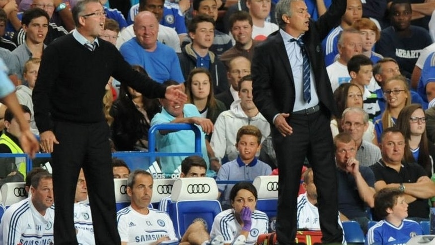 Aston Villa's Scottish manager Paul Lambert (L) and Chelsea's Portuguese manager Jose Mourinho (R) react during the English Premier League football match between Chelsea and Aston Villa at Stamford Bridge in London on August 21, 2013.