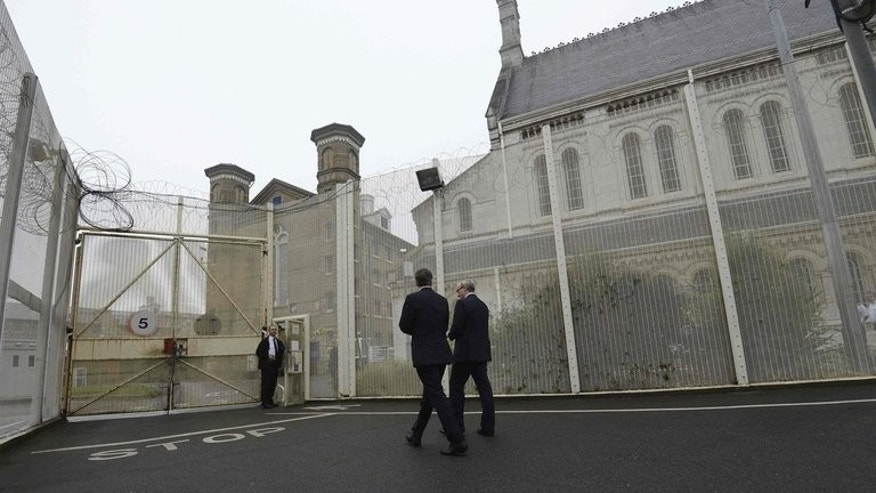 "Prime Minister David Cameron visits Wormwood Scrubs Prison in west London last October. A triple murderer is appealing to the European Court of Human Rights to challenge his ""life means life"" sentence, the first Briton to do so."