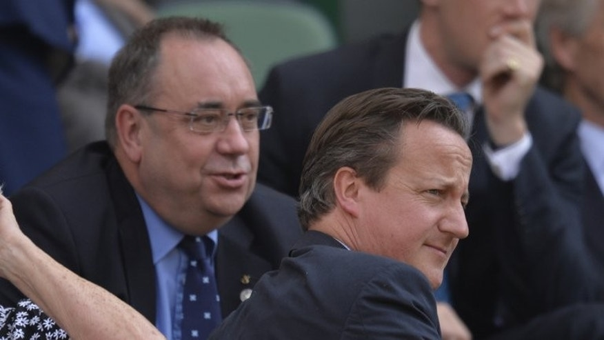 Alex Salmond (left) with David Cameron at the Wimbledon men's singles final on July 7. With 13 months to go until the historic vote on September 18, 2014, only a third of Scotland's 5.5 million-strong population are currently planning to vote in favour of independence, according to opinion polls.