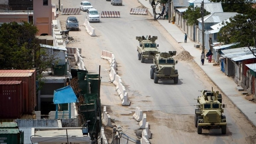 A convoy of AMISOM drives down the main road leading to the airport in the Somali capital Mogadishu on August 5, 2013. Somalia's government vowed Wednesday to deliver justice in the case of a local woman who alleged she was gang raped by African Union troops and Somali soldiers.