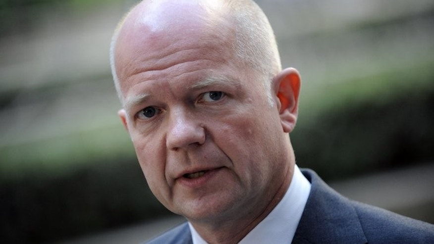 "Britain's Foreign Secretary William Hague answers journalists' questions on July 22, 2013 at the EU Headquarters in Brussels. Hague said Wednesday that he hoped the alleged chemical weapons attack in Syria would ""wake up"" President Bashar al-Assad's supporters to the nature of his regime."
