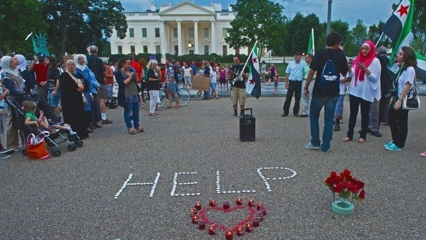 "Demonstrators calling for help from US President Obama on the Syrian revolution protest in front of the White House on August 21, 2013, in Washington, DC. A year after Washington said using chemical weapons would cross a ""red line,"" the alleged gas attack outside Damascus has exposed how few options the West has to try to end Syria's violence."