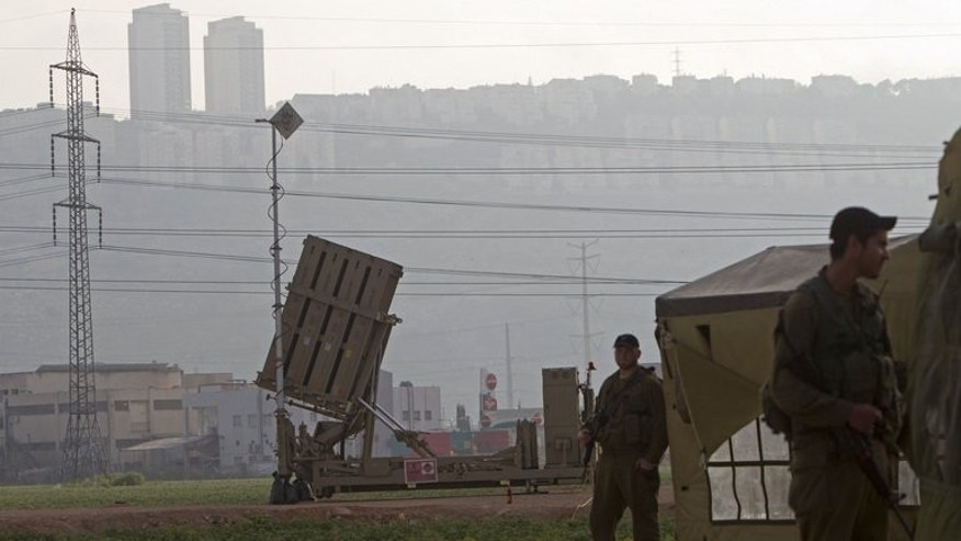 "An ""Iron Dome"" short-range missile defence system is pictured near the northern Israeli city of Haifa on May 6, 2013. Gunmen fired four rockets at Israel from the southern Lebanese port of Tyre on Thursday, a Lebanese security source said, as witnesses reported explosions near Israel's northern border."
