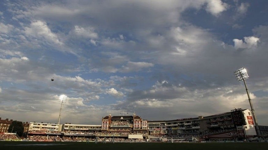 A general view of the ground, with floodlights on in the early evening sunshine during play on the second day of the fifth Ashes cricket test match between England and Australia at The Oval cricket ground in London on August 22, 2013.