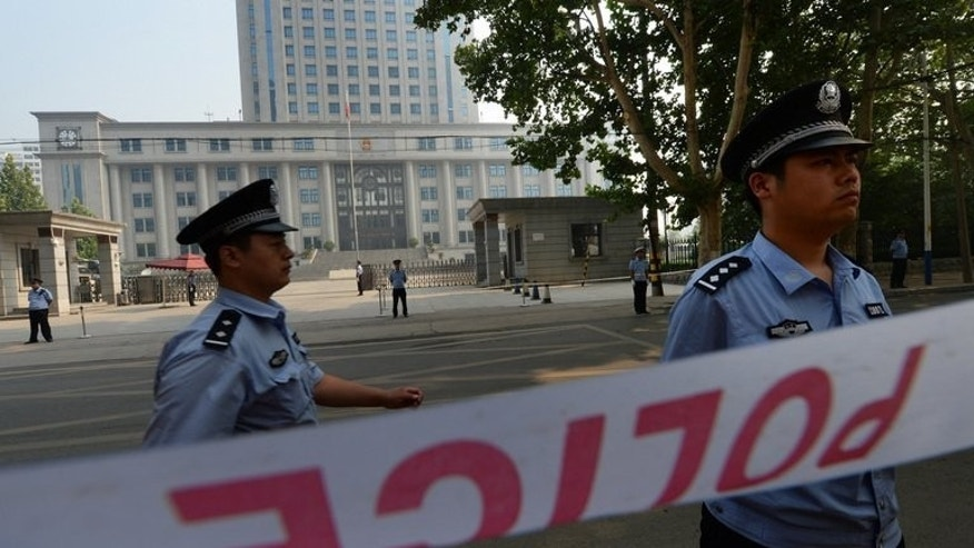 Police patrol outside the court as disgraced politician Bo Xilai stands trial in Jinan on August 23, 2013. Some experts believe the verdict and sentence have already been decided upon and the hearing is an attempt to project transparency.