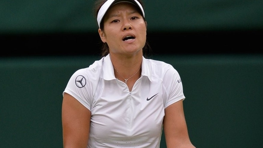 China's Li Na reacts during a match at the Wimbledon Championships in London, on July 2, 2013. The world number six, now a veteran at 31, has developed a reputation as a prickly character in a nation where sports stars typically keep their emotions strictly in check after years in the rigid state sports training system.