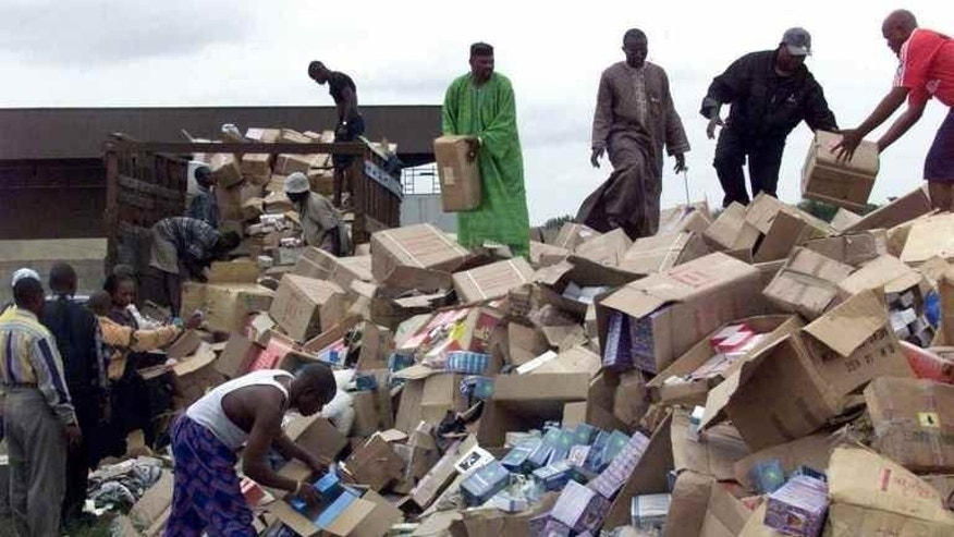 This file photo shows officials offloading boxes of fake drugs for destruction, in Lagos, on October 13, 2001. From Cameroon to Ivory Coast, Kenya to the DR Congo, traders in counterfeit drugs do a thriving business with the utmost cynicism and sometimes at the cost of human lives.