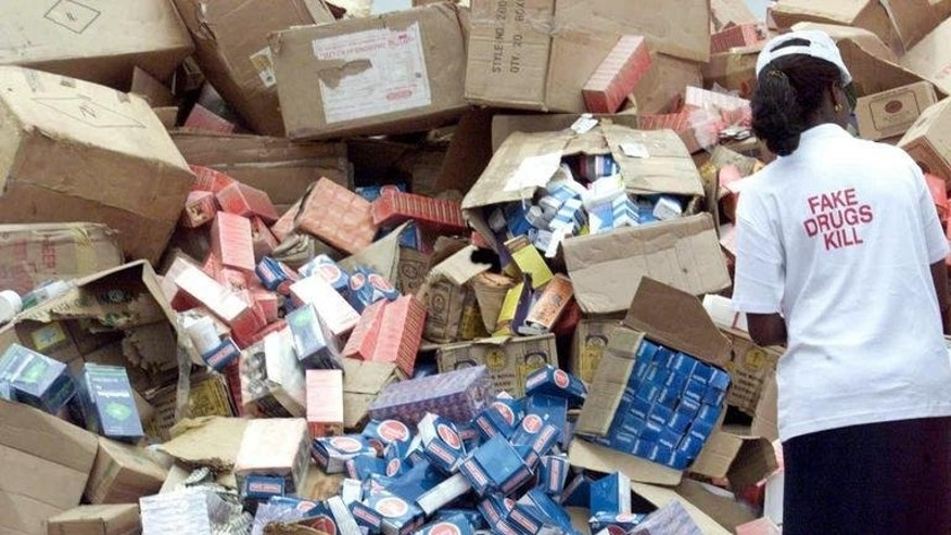 An official offloads cartons of fake drugs for destruction in Lagos, on October 13, 2001. At best, fake prescription drugs have no effect, acting like placebos, but at their worst, they are highly toxic. Either way they bring in vast sums of money for those behind the illicit traffic.