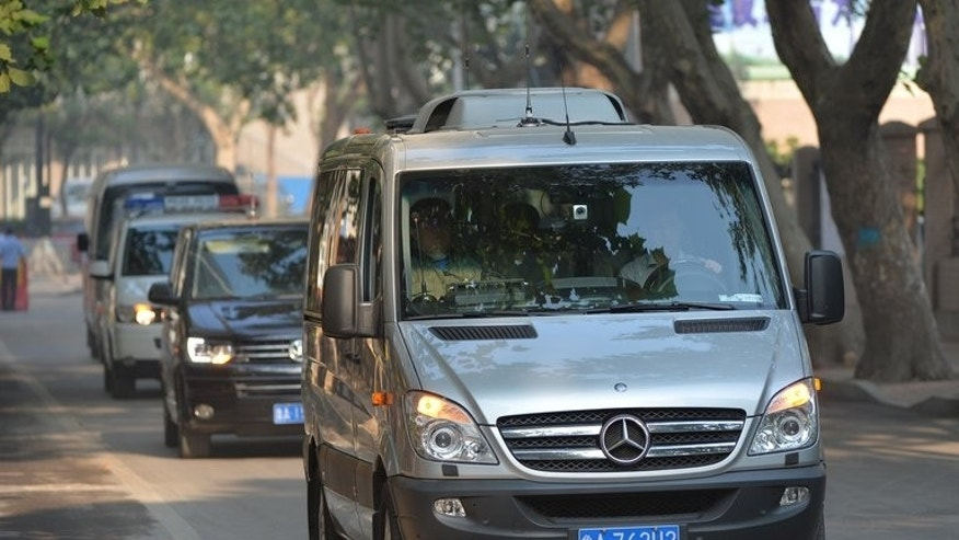 The convoy believed to be carrying disgraced politician Bo Xilai arrives at the Intermediate People's Court in Jinan, Shandong Province on August 23, 2013, for day two of his bribery trial.