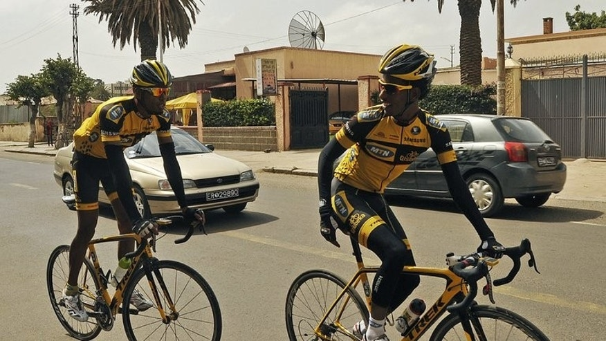 Jani Tewelde (L) and Meron Russom train in Asmara, the capital of Eritrea, on July 20, 2013. They are two of only six professional cyclists who compete internationally for Eritrea, a country more often associated with political repression than world-class athleticism.