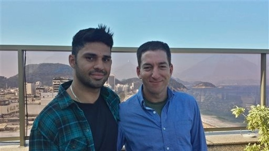 In this undated photo released by Janine Gibson of The Guardian, Guardian journalist Glenn Greenwald, right, and his partner David Miranda, are shown together at an unknown location. Miranda, the partner of Greenwald, a journalist who received leaks from former National Security Agency contractor Edward Snowden, was detained for nearly nine hours Sunday, Aug. 18, 2013, under anti-terror legislation at Heathrow Airport, triggering claims that authorities are trying to interfere with reporting on the issue. (AP Photo/Janine Gibson, the Guardian) CREDIT MANDATORY