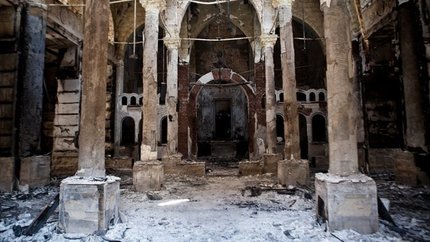 The Amir Tadros coptic Church in Minya, some 250 kms south of Cairo, which was set ablaze on August 14, 2013, in a photo taken on August 18. Egyptian authorities must protect churches and Christian homes and businesses from attack and Islamists must stop inciting sectarian violence, Human Rights Watch said on Thursday.