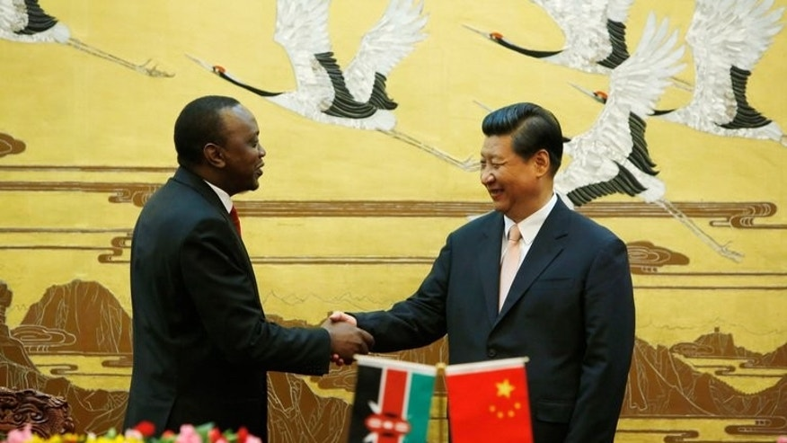 Kenya's President Uhuru Kenyatta (L) and his Chinese counterpart Xi Jinping shake hands during a signing ceremony at the Great Hall of the People in Beijing, on August 19, 2013. Just months into his presidency, Kenyatta highlighted China's growing economic clout in the region by choosing to make Beijing the destination of his maiden state visit.