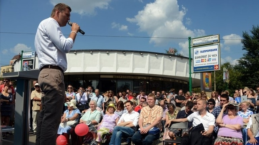 Russian opposition leader Alexei Navalny gives a speech during a campaign meeting in Moscow on August 8, 2013. The Moscow election commission is to consider whether to disqualify protest leader Alexei Navalny from taking part in elections for city mayor on September 8, the Russian capital's election chief said Thursday.