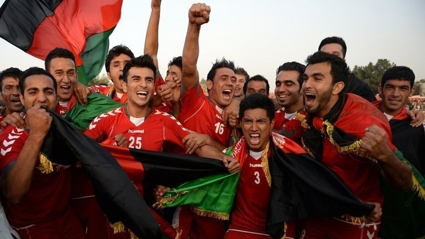 Afghan players celebrate their 3-0 win against Pakistan in Kabul on Tuesday. Pakistan Thursday appointed Bahrain's Mohammed Shamlan as their new coach to change the dwindling fortunes of their national team which lost to neighbouring Afghanistan in a historic match this week.