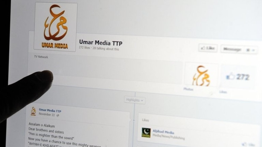 A Pakistani journalist gestures at a Facebook page used by Tehreek-e-Taliban Pakistan (TTP) on a laptop computer screen in Islamabad on December 7, 2012. A Pakistani militant group Thursday welcomed a call for dialogue by Prime Minister Nawaz Sharif with extremists to end bloodshed that has left thousands dead.