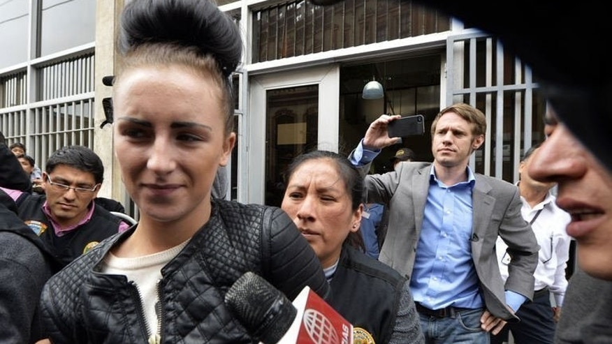Irish citizen Michaella McCollum Connolly, 20, is escorted out of the Callao prosecutor's building in Lima on August 20, 2013, to be taken to the district court with her British companion Melissa Reid. The pair were arrested at Lima airport as they tried to board a flight to Spain carrying what Peruvian police said was 11 kilos of cocaine.