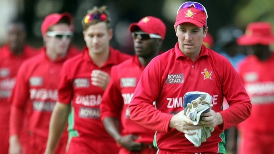 This file photo shows Zimbabwe's captain Brendan Taylor leaves the field with teammates after an ODI series match with India, in Harare, on August 3, 2013. Zimbabwe go into Friday's first Twenty20 international against Pakistan at Harare Sports Club with Taylor confident that the players have put their most recent scuffle with the board behind them.