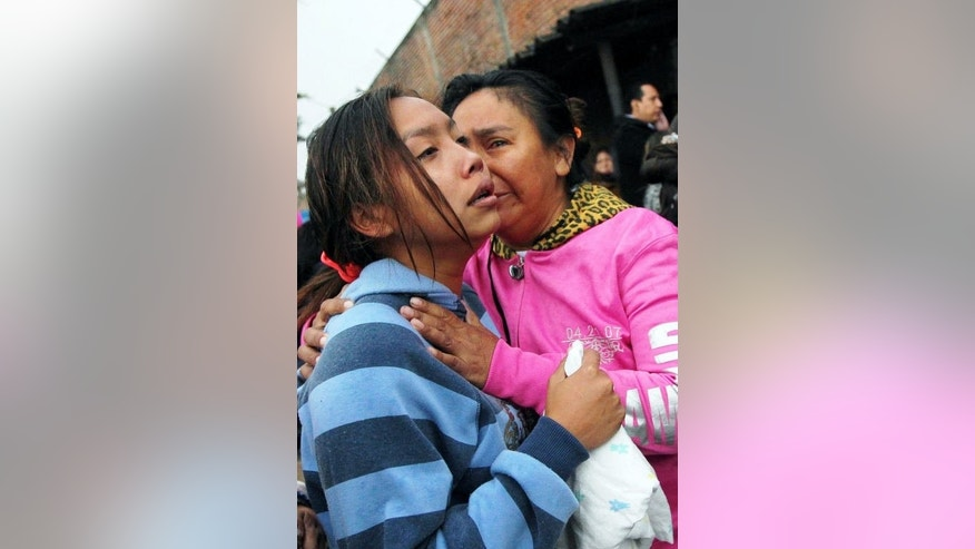 Relatives of inmates cry outside the Palmasola prison in Santa Cruz, Bolivia, on August 23, 2013.