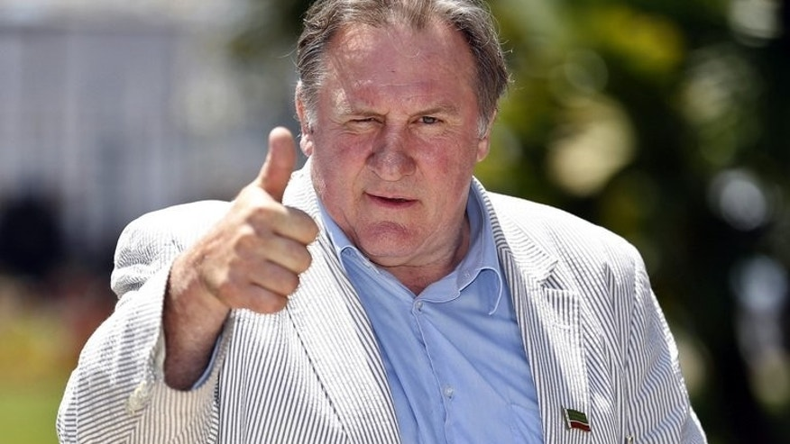 "Gerard Depardieu at a news conference in Nice, France, on June 6. the veteran French actor insists the controversy over his quitting France was ""a big misunderstanding"" and that he still loves his country."