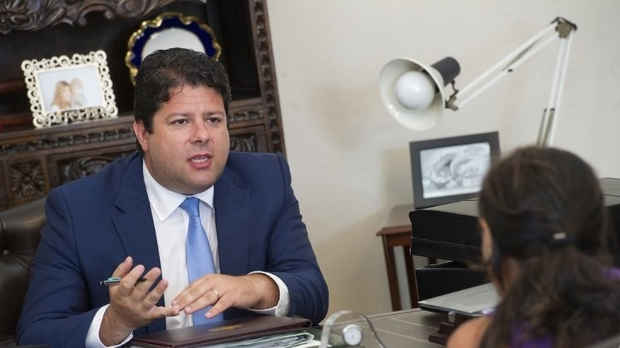 Fabian Picardo speaks during an interview with AFP in his Convent Place office, Gibraltar on August 14. Spanish fishing boats will be allowed to return to disputed waters off Gibraltar but a controversial concrete reef will remain, the British outpost's political chief said in an interview published Friday.