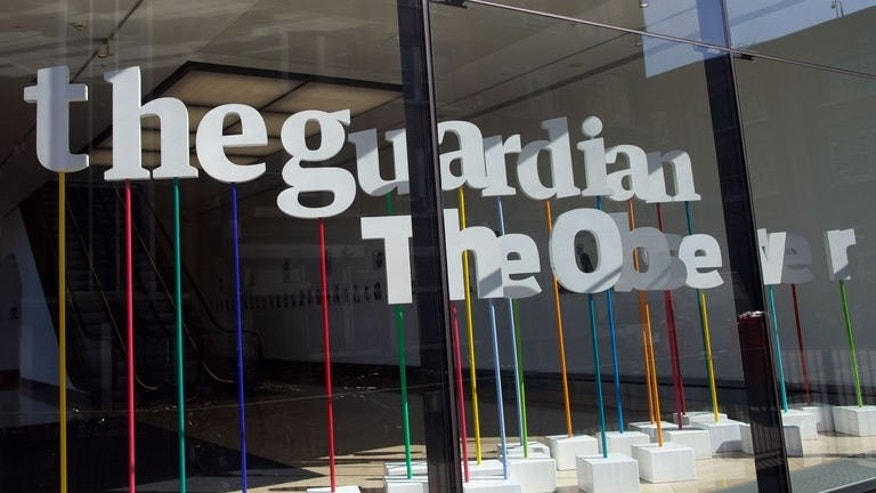"A picture shows the offices of the Guardian newspaper in central London on August 20, 2013. Britain's Guardian newspaper said Friday it is teaming up with the New York Times to work on documents obtained by fugitive US security employee Edward Snowden because of ""intense pressure"" from the British government."