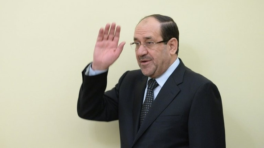 Iraqi Prime Minister Nouri al-Maliki waves as he arrives for an agreement signing with Indian Prime Minister Manmohan Singh in New Delhi on August 23, 2013. Iraq's prime minister on Friday pitched for investment from India to rebuild his war-shattered nation, which is a critical energy supplier to New Delhi.