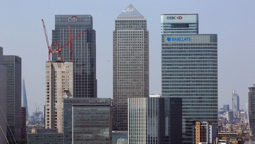 View of London's Canary Wharf business district. London shares opened mixed on Friday ahead of revised second quarter GDP figures later in the day, dealers said.