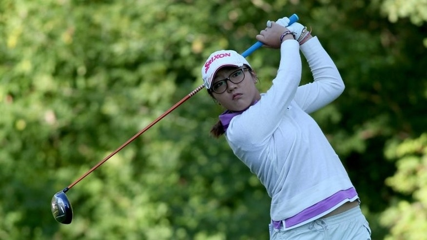 Lydia Ko of New Zealand hits her tee shot on the fifth hole during the CN Canadian Women's Open at Royal Mafair Golf Club in Edmonton, Alberta, on August 22, 2013. Ko got off to a successful start in her title defence, firing a five-under par 65 to grab a share of the lead.