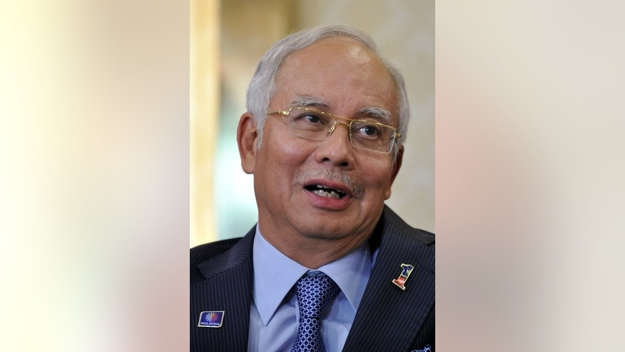 Malaysia's Prime Minister Najib Razak speaks during a press conference in Kuala Lumpur on May 7, 2013. Critics attempted to draw a link between PM and the killing of Mongolian national Altantuya Shaariibuu.
