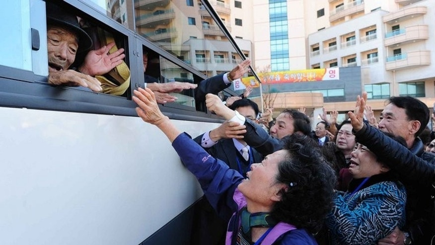A bus-load of North Koreans wave goodbye to family members at the North's Mount Kumgang resort after a three-day reunion, pictured on November 1, 2010. Talks between the two countries on resuming reunions were being held Friday.